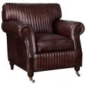 Sillón de piel marrón de estilo vintage con ruedas metálicas