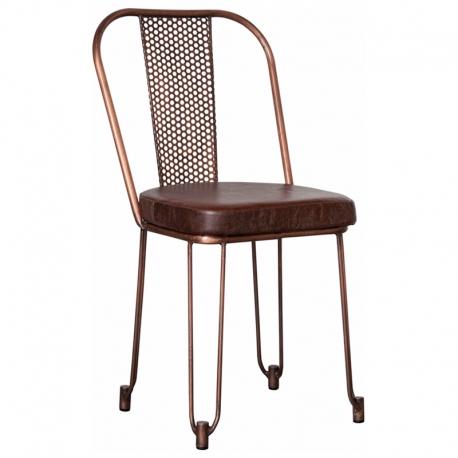 Silla de comedor con forma industrial y asiento en piel