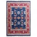 Alfombra de comedor realizada con lana auténtica de origen indio de colores vivos rojos y azul marino.