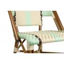 Silla de terraza bistro parisina realizada con estructura metálica y asiento en ratán sintético con colores crema