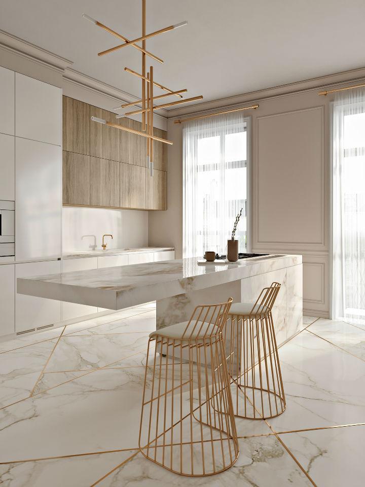 isla de cocina en mármol con taburetes dorados
