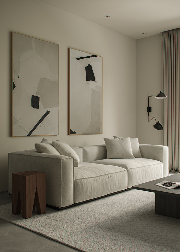 Sofá color beige con alfombra a tono